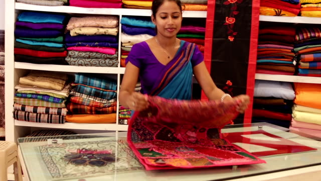 Sri Lankan woman in a Sari as a shop assistant video