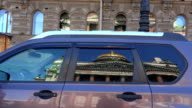 St. isaac's cathedral. The reflection in the glass of the car. 4K. video