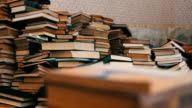 Stack of Books Scattered on the Floor in the Library video