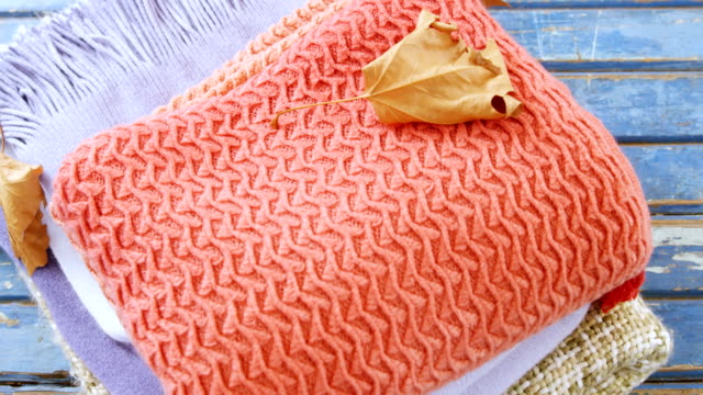 Stack of cloth on wooden table video