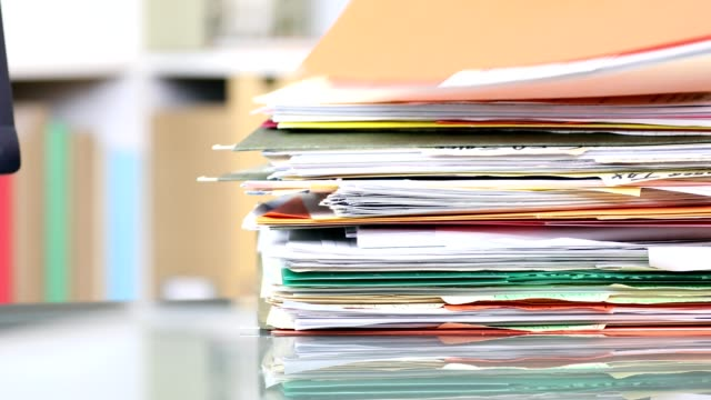 Stack of files, documents being removed from office desk. video