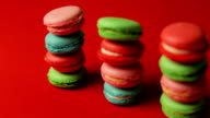 Stack of macaroons on red background video