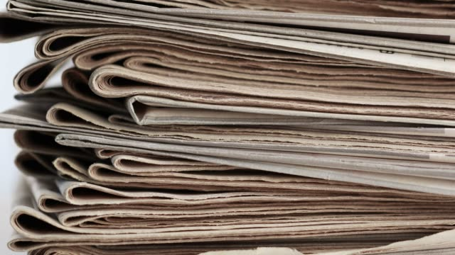 stack of newspapers video