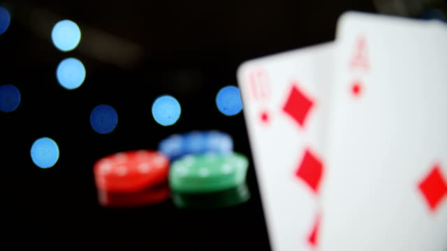 Stack of playing cards on poker table 4k video