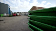 Stack of skips and truck at a recycling centre video