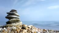 Stacked pebbles on a beach video