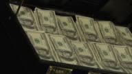 Stacks of 100 dollar bills in a briefcase video