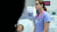 Staff In Emergency Room Meeting Around Young Girl's Bed video