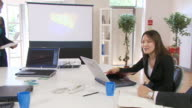 Staff work together in offices video