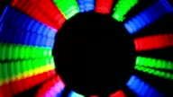 Staffs rotate on circle in dark blinking different colours video