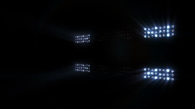 Stage, concert or stadium lights flashing, with sound. Cold colors. video