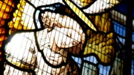 Stained glass window showing Jesus and an angel. video