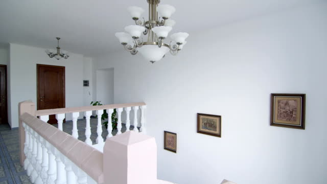 Staircase with traditional white balustrade video