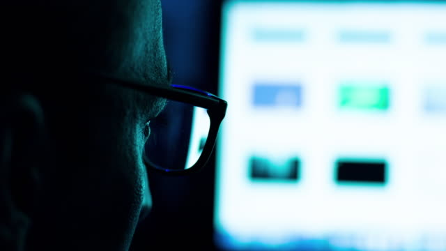Stalker, Businessman or Hacker Working On Computer video