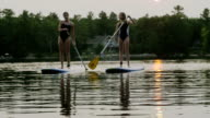 Stand up paddle boarding on a lake video