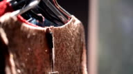 Stand with hangers with clothes. inside look at woman choice video