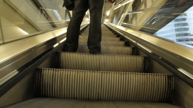 Standing on Escalator going up video