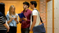 Standing students talking in locker room video