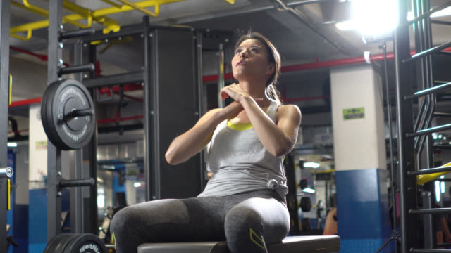 Standstill view of woman doing abs on an adjustable bench video