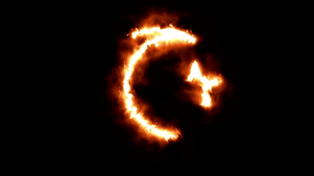 Star and Crescent Lighting up and Burning in Flames video