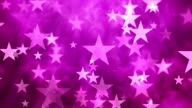 Star particles on pink background video