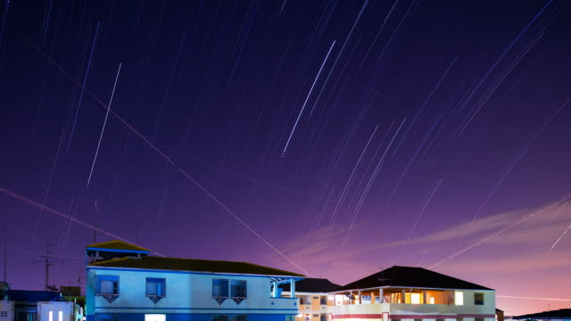 Star trails Across Plane Light Trails and Moon video