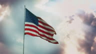 Stars and Stripes Flying in Wind Against Dramatic Sky video