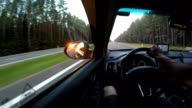 Start of the journey. Driving a car on sunrise. video