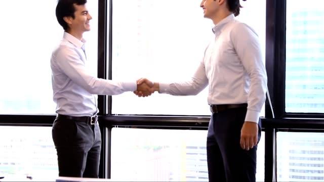 Start-up Meetings:Business handshake agreement for good job. video