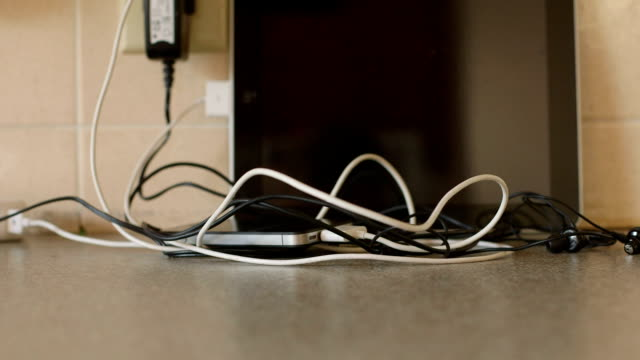 Static of Tangled Cords Headphones and Old iPhone video
