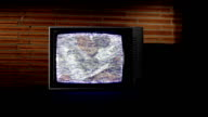 Static TV with money rotating video