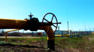 Station for processing and cleaning natural gas. Pipeline with shut-off valve. A refinery of oil and gas materials. Production of fuel. Natural resources video