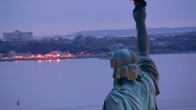 Statue of Liberty at dusk,  aerial shot video
