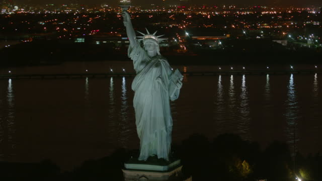 Statue of Liberty at night, aerial shot video