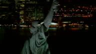 Statue of Liberty at night, closeup aerial shot video