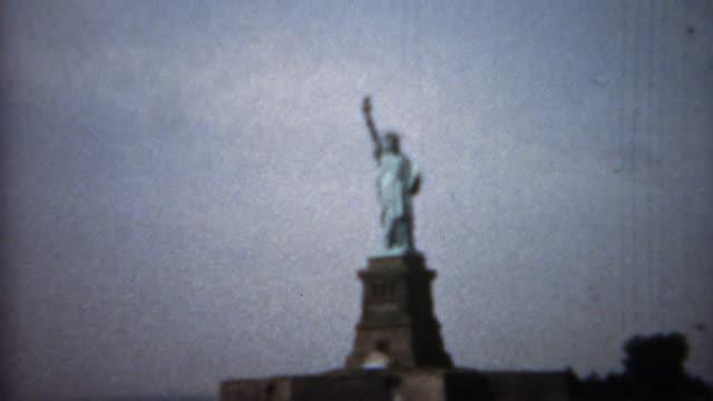 1961: Statue of Liberty closeup tilt up and far shot. video