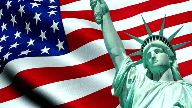 Statue of Liberty of American USA with waving flag in background video