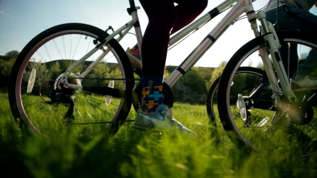 Steadicam shot of healthy man and woman pedaling fast. video