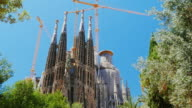 Steadicam shot: The famous temple of the Sagrada Familia in Barcelona, the camera moves in the direction of the church video