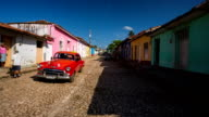 Steady Cam shot of Trinidad Cuba with Vintage Car video