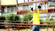 steadycam shot of man walking with boombox video