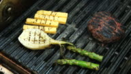 Steak being cooked with onion, cheese and asparagus. video