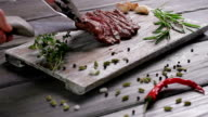 Steak on a wooden board. video