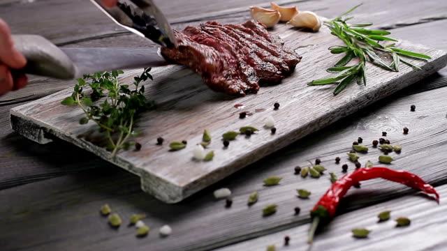 Steak on a wooden board. video