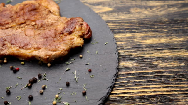 Steak on a wooden table video