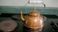 Steam Boils From a Copper Tea Kettle on a Stove Top video