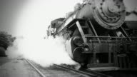 Steam Engine Train Leaves Station - BW video