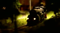 Steam locomotive  with cars toy goes in the child world video