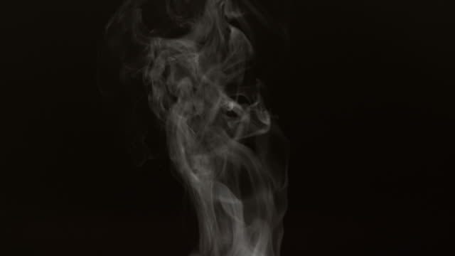 Steam on black background in slow motion video