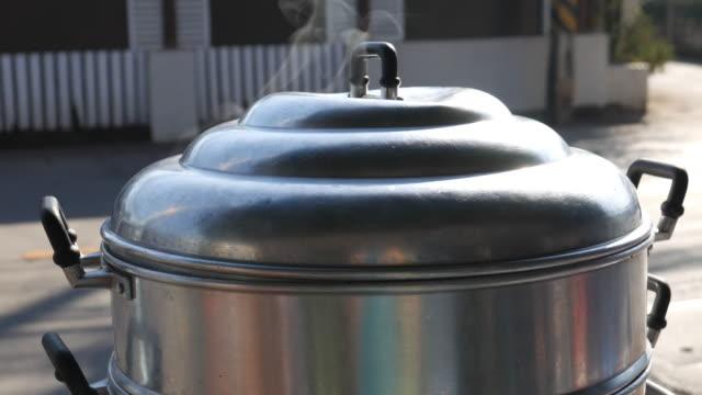 4K : Steam on pot in kitchen, close up video